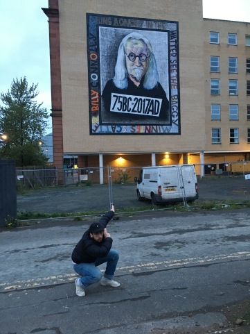 Eugenio slav-squatting at the Billy Connelly mural